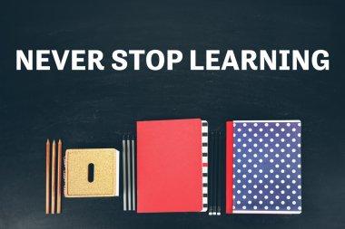 Business training concept. School supplies near blackboard, close up