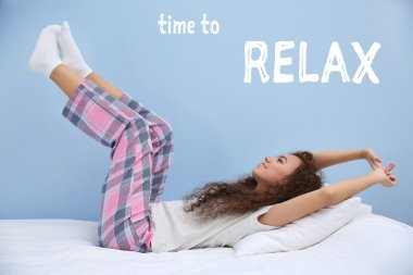 Beautiful young woman stretching after wake up. Text TIME TO RELAX on blue background.