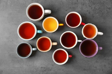 Cups of tea on table, top view