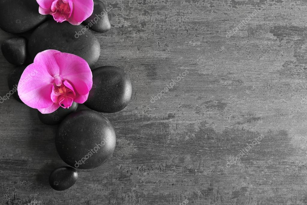 Spa stones with orchid flowers
