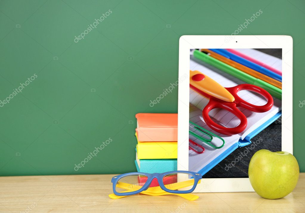 Tablet With Stationery Wallpaper On Screen Against