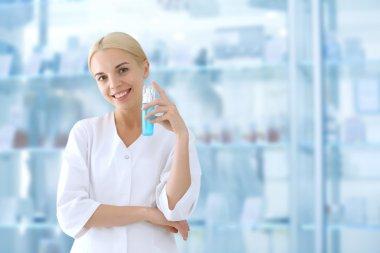 Cosmetologist holding cream beside showcases