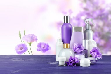Set of body care products on eustoma flowers background