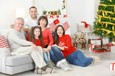 Happy family in living room decorated for Christmas