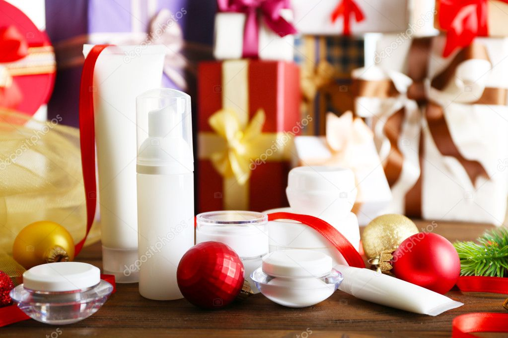 Beauty cosmetic products with Christmas decoration on blurred gifts background