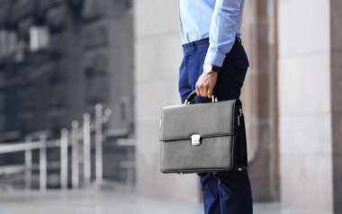 Lawyer holding briefcase on the street