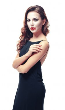 Beautiful young woman dressed as vampire for Halloween, isolated on white