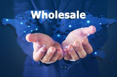 Wholesale concept. Businessman in suit on dark background