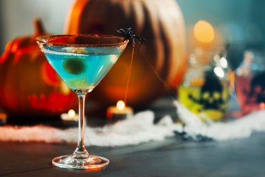 Bright tasty cocktail for Halloween party, close up view
