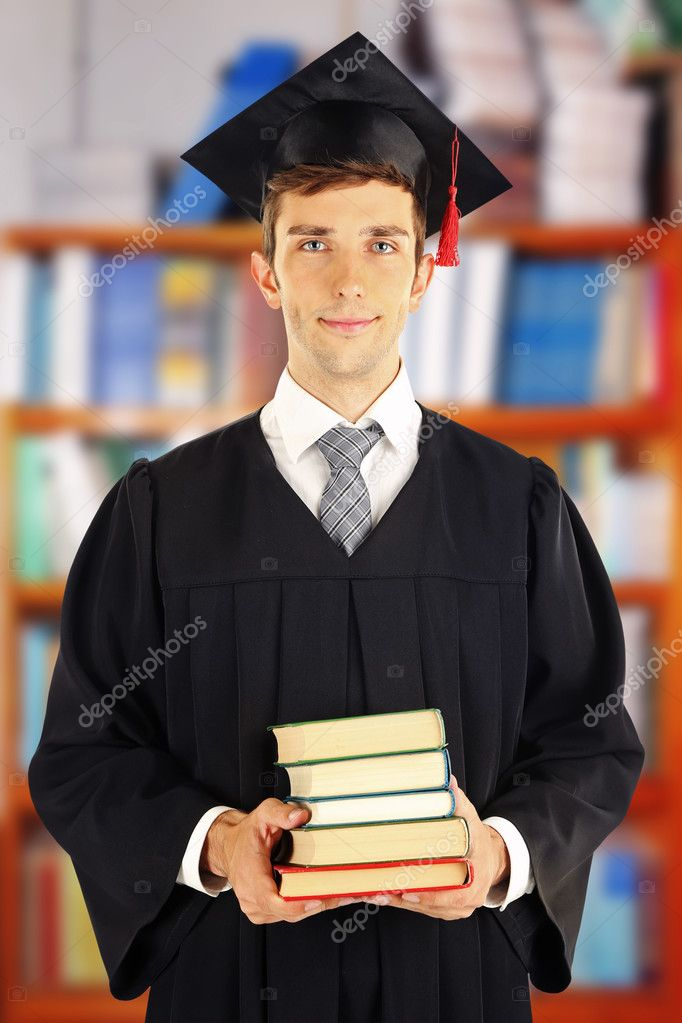 Yong man in graduation gown and cap — Stock Photo © belchonock ...
