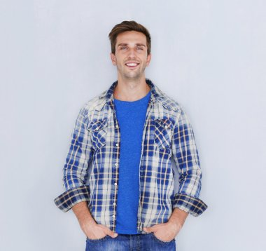 Young happy man on light background