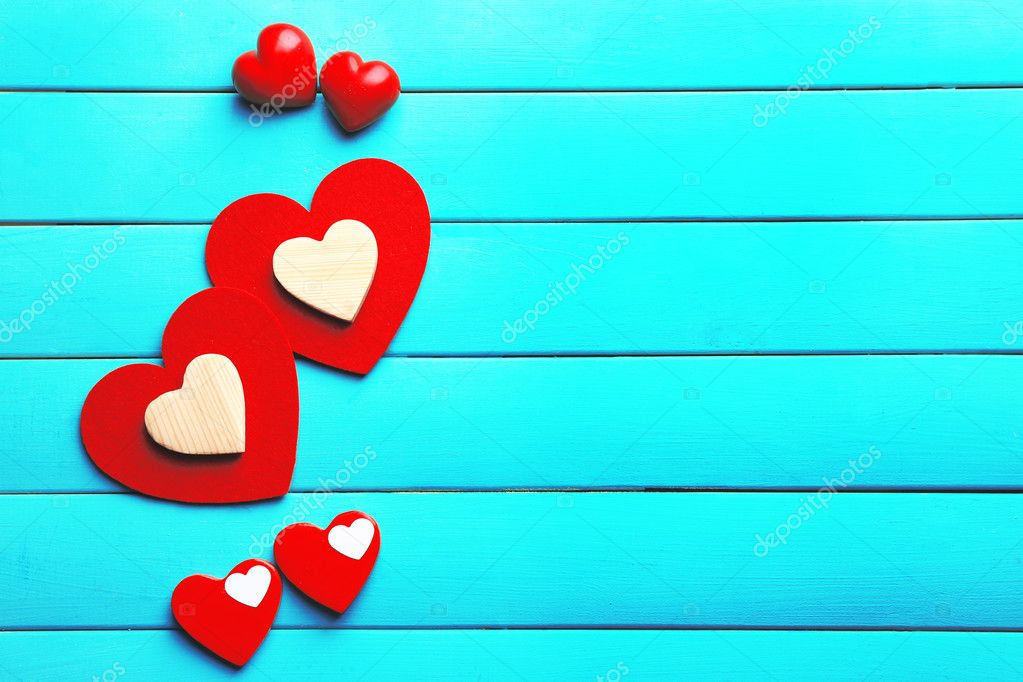Red hearts on turquoise background