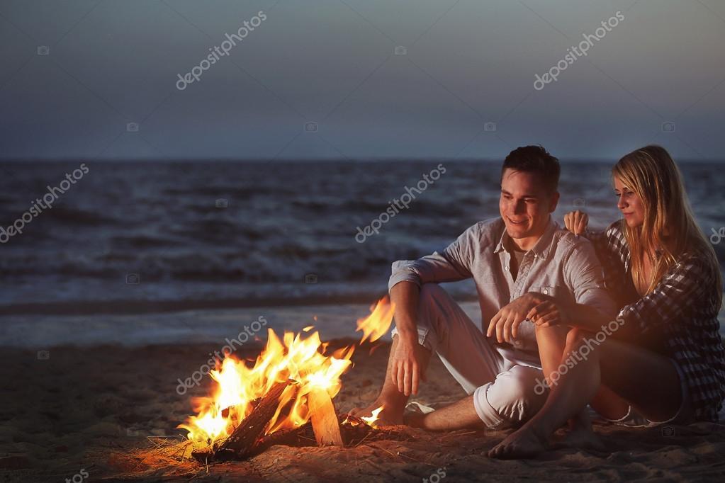 Lovely couple near fireplace