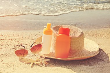 Sun protection set on beach. Skin care concept.