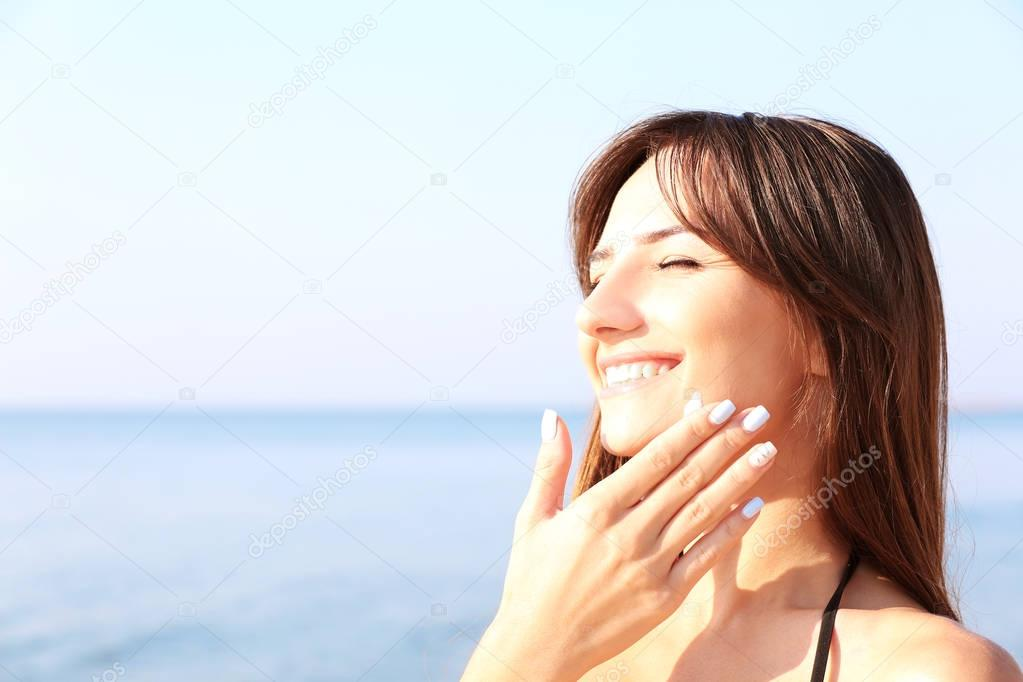 Image result for woman using sunscreen