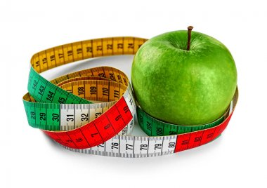Dieting concept. Green apple with measuring tape isolated on white