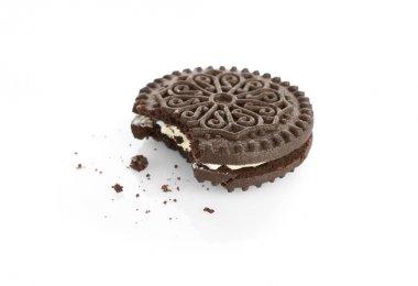 Bitten tasty cookie and crumbs