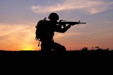 Silhouette of soldier on sunset