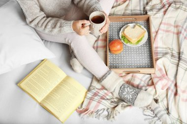 Girl with food reading book