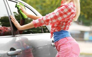 Woman wiping car