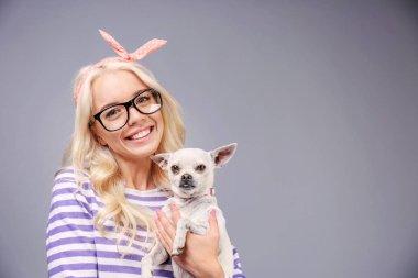 girl holding cute dog