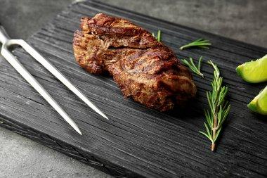 tasty steak with rosemary