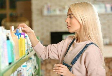 woman selecting animal shampoo