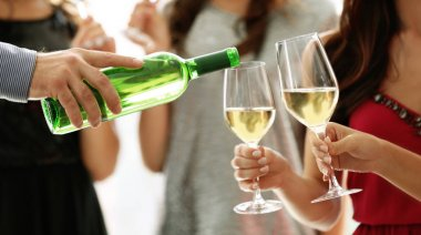 Man pouring white wine