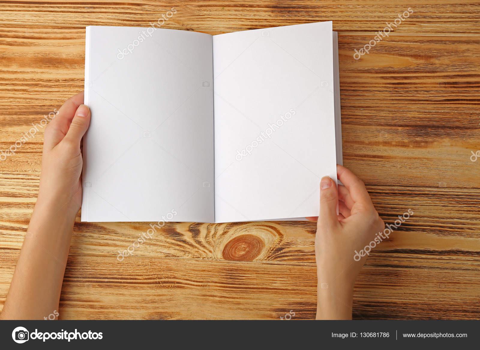 hands holding blank open brochure stock photo belchonock 130681786