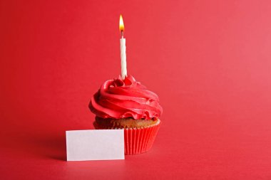 Fresh tasty cupcake with candle