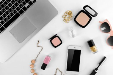 Workplace with laptop and women accessories