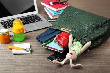 handbag full of different things