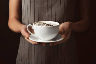 holding cup of tasty coffee