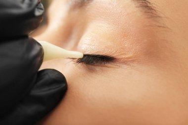 Professional tattooist making permanent makeup