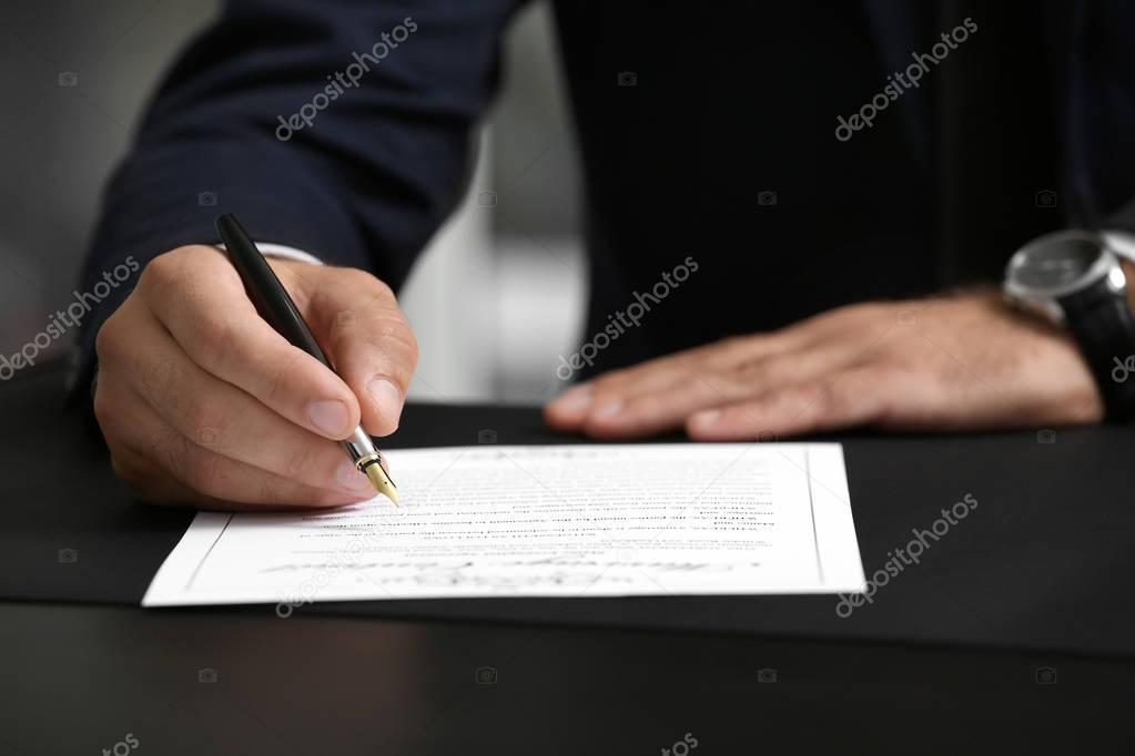 Man signing marriage contract