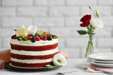 Delicious cake with fruits and berries