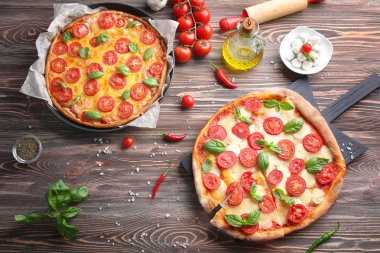 Delicious pizzas on kitchen table