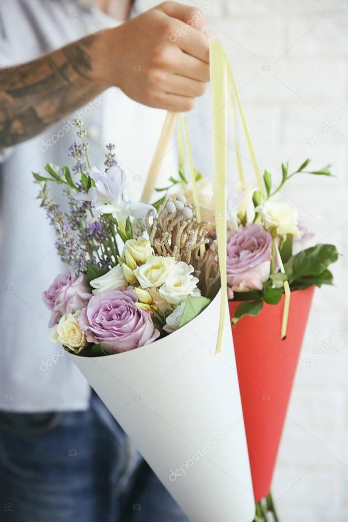 Man holding beautiful bouquets, closeup