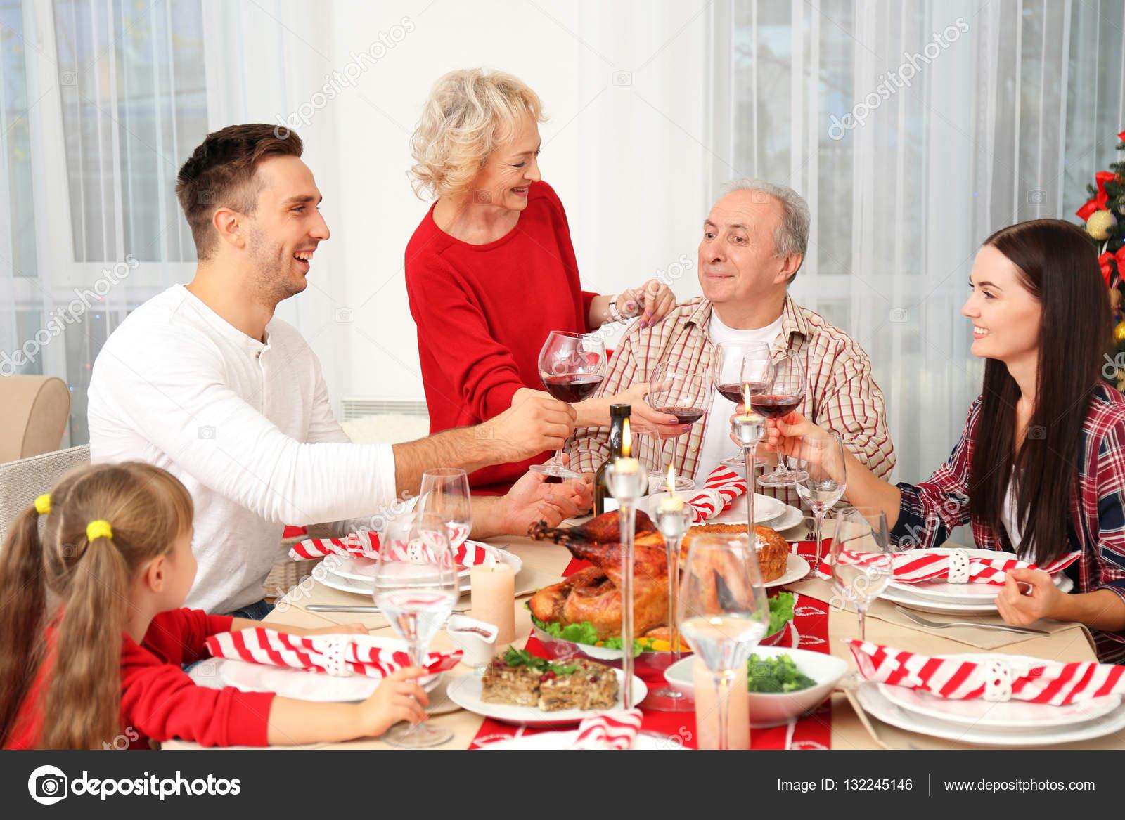 Happy Family Having Christmas Dinner In Living Room Stock Photo 132245146