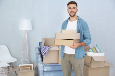 House moving concept. Man holding cardboard boxes, closeup