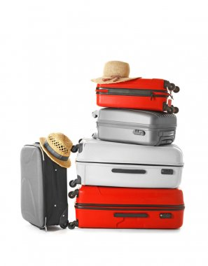 Modern suitcases and hats