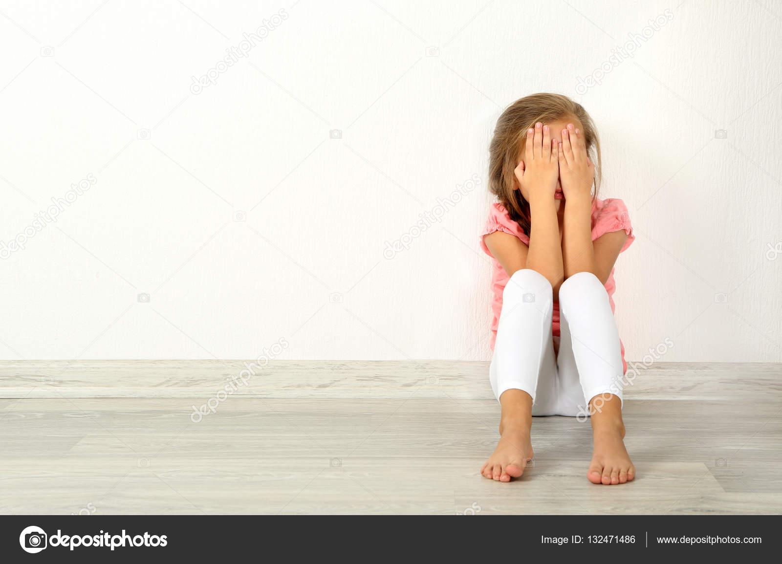 Crying Little Girl On Floor Stock Photo Belchonock 132471486