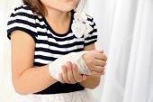 little girls wrist with  bandage