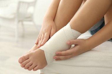 ankle with elastic bandage
