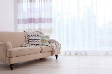 sofa on curtain background