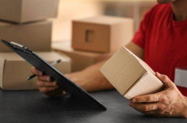 Courier holding carton box