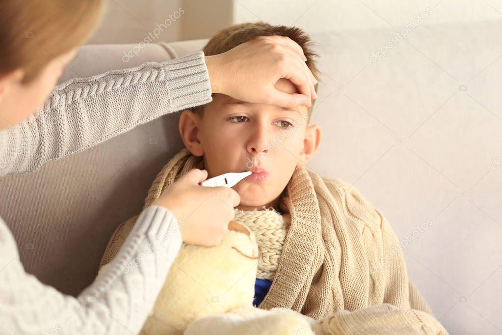 Small sick boy — Stock Photo © belchonock #132472112