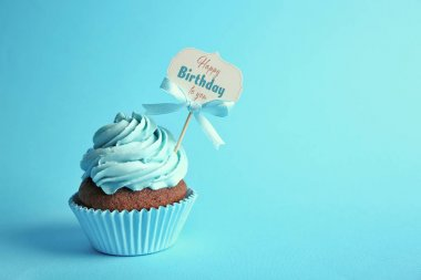 Delicious cupcake with greeting card