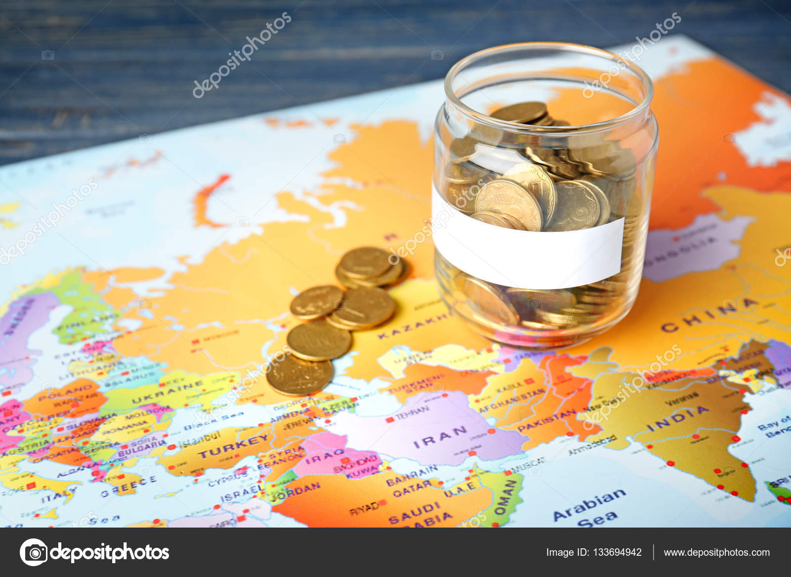Jar with money on world map stock photo belchonock 133694942 jar with money on world map stock photo gumiabroncs Choice Image