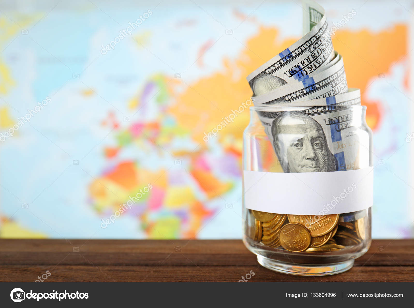 Jar with money on world map stock photo belchonock 133694996 jar with money on world map stock photo gumiabroncs Gallery